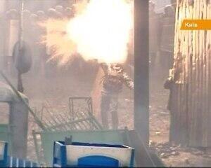 Riot policeman don't have time to throw a grenade at the protesters, it exploded in his hands