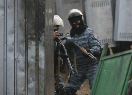 Riot police with shotgun