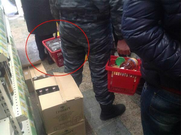 Policeman in the photo buys vodka for desinfect wounds