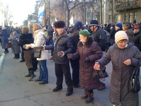 Old women help youth to fight with police in Kyiv