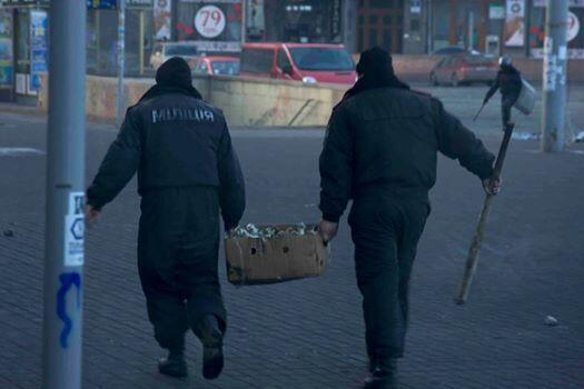Policemen with molotov coctails