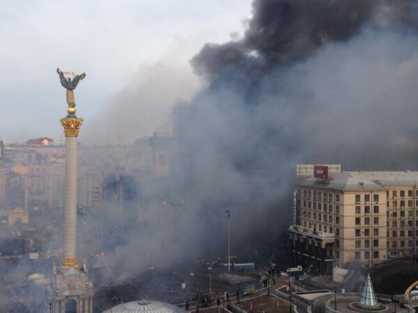 Huge plumes trades union building in Kiev. Flames visible through windows.