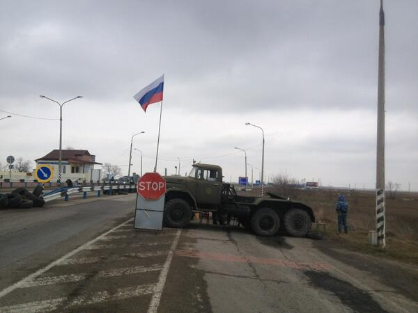 Russian flags have gone up on two border points btw Crimea and mainland Ukraine. Pro-Russia men w/guns checking cars