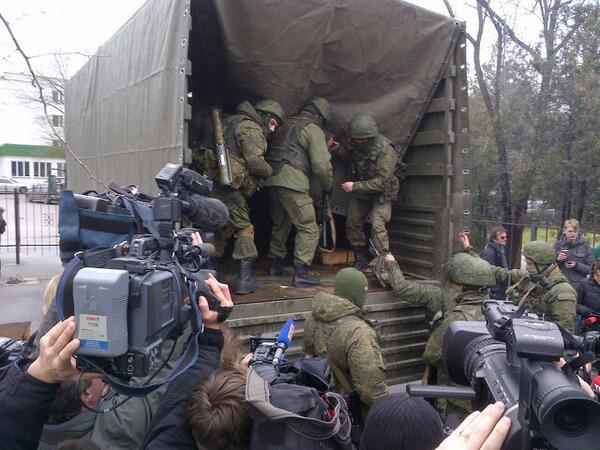 2-3 dozen militiamen at Simferopol Crimea airport quickly piled into a truck - with no plates - and are leaving.