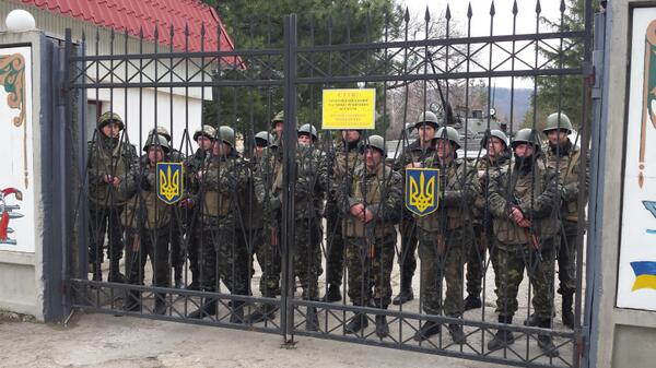 Extraordinary standoff. Ukraine soldiers defiant behind gates of Perevalne base. Won't surrender. Crimea