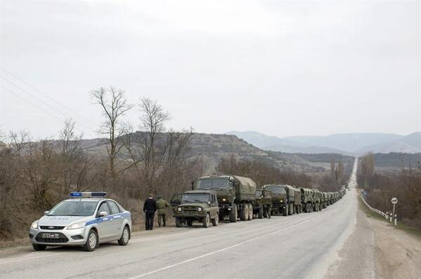 Military vehicles in Crimea accompanied by police cars with Moscow number plates