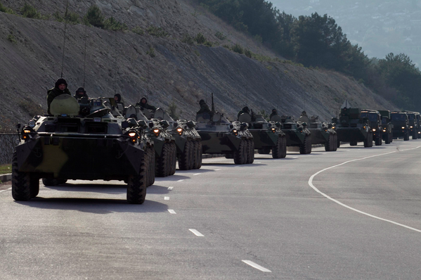 Convoy of military vehicles travels on the road from Sevastopol to Simferopol, Crimea, Ukraine.