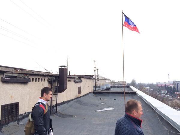 On the roof of the seized police HQ in Horlivka. Ukrainian flag hoisted down, 'Donetsk Republic' flying over now