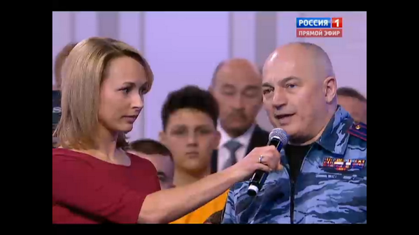 Russian host introduces Crimea Berkut fighteras a hero to Putin. Putin agrees
