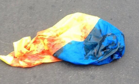 Ukrainian flag soaked in blood in Donetsk tonight.
