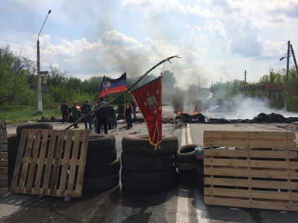 Burning pro-Russian militants barricade in Sloviansk now. Scene of apparent shootout. Trucks riddled with bullet holes.