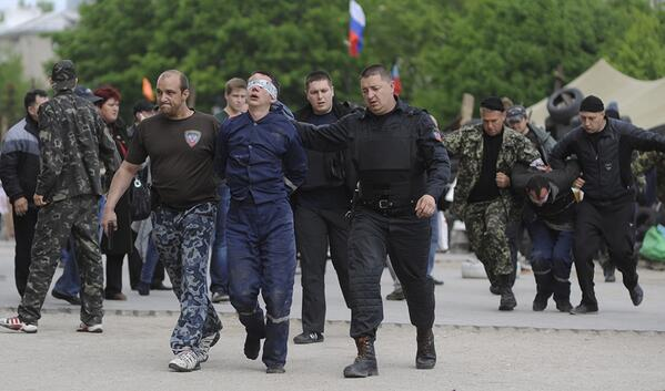 Detained firemen being dragged away by the geniuses at the Donetsk Republic Ukraine