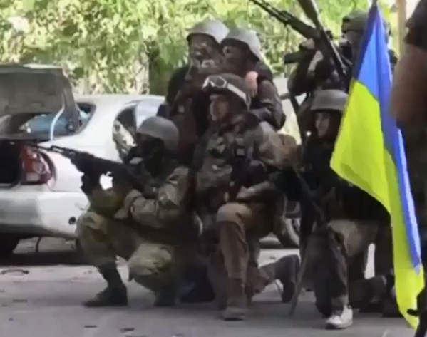 Ukrainian fighters after regaining control of the center of Mariupol this morning.