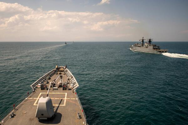 In the Black Sea - Romanian navy frigate ROS Regina Maria passes USS Vella Gulf at close of Exercise Breeze