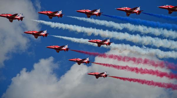 Royal Air Force fly over a crowd during the Farnborough Airshow