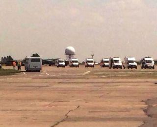 Ambulances wait for wounded Ukrainian army troops in Dnipropetrovsk airport