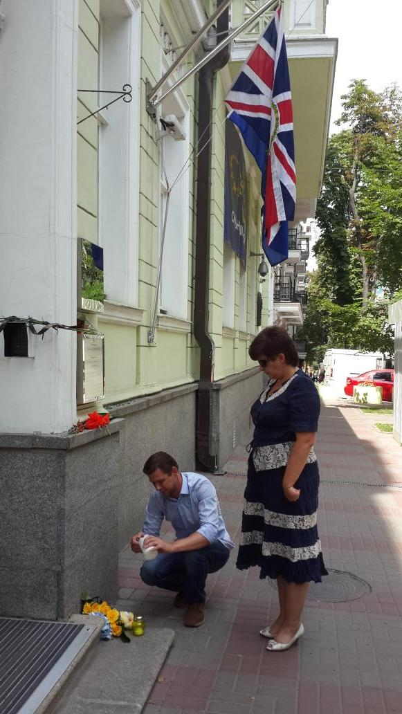 Ukraine's human rights commissioner Valeria Lutkovska laying flowers in front of the Embassy MH17