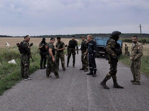 Terrorists at the crash site of MH17 boeing777 Malaysia airlines