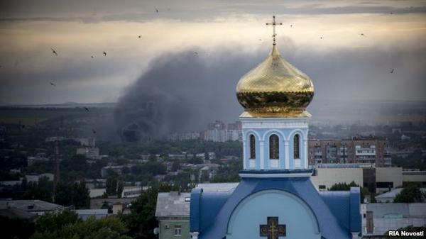 Buildings burning in the center of Luhansk