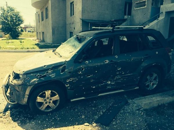 Car after shelling close to railway station Donetsk