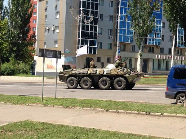 Some rebel tanks, buses and cars of militants heading back toward center of Donetsk