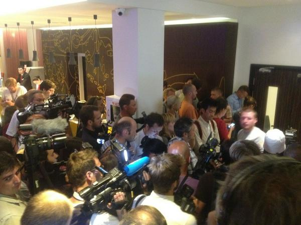Scrum at a hotel door behind which Borodai is talking to Malaysians. MH17