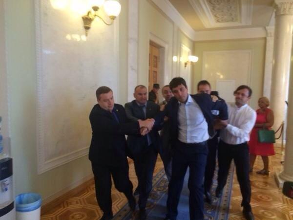 Ukraine parliament today: pro-Russia MP Levchenko literally kicked out of the building
