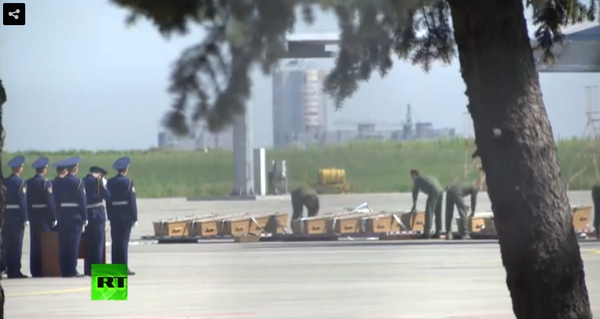 Bodies being loaded onto plane at Kharkiv Airport, Ukraine