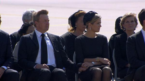 Dutch King and Queen holding hands as MH17 coffins arrive in the Netherlands