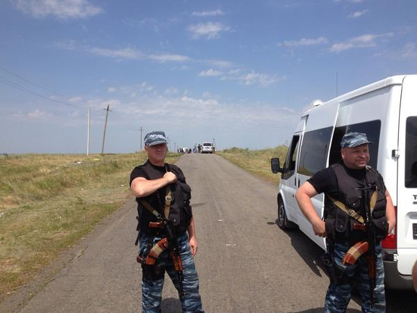 MH17 crash site now - armed militiamen protecting intl experts and not crash site