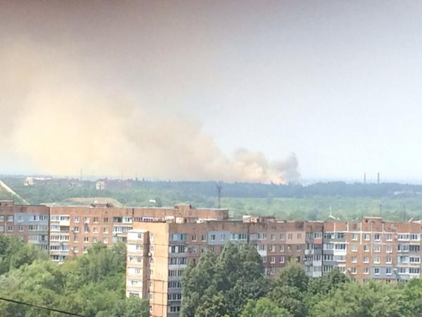 Big hit on outskirts of donetsk. Dust and orange smoke rising from very large area