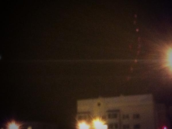 More gunfire from militants positions near Donetsk train station. Rounds glowing red hot in the black sky