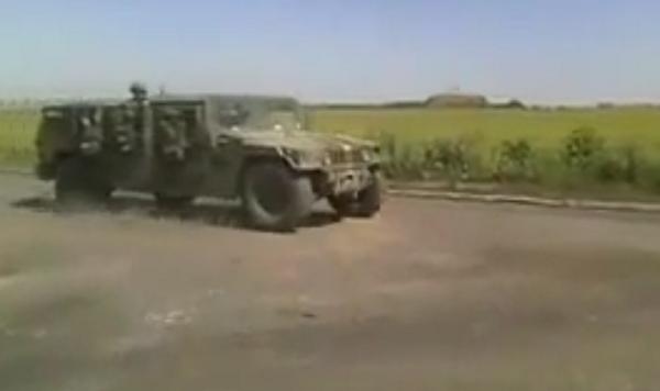 An Ukrainian army convoy passes Stizhkove. Humvees and APCs