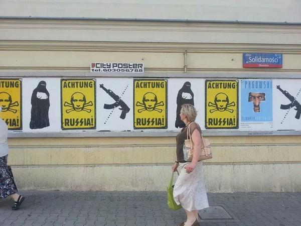 Warsaw, Poland: anti-Putin posters Ratusz Arsenal metro station