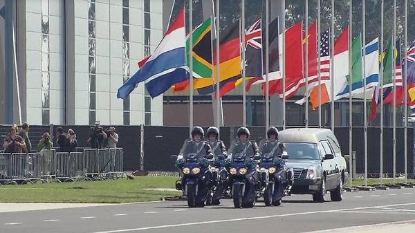 Coffin with remains victims MH17 brought to identification centre