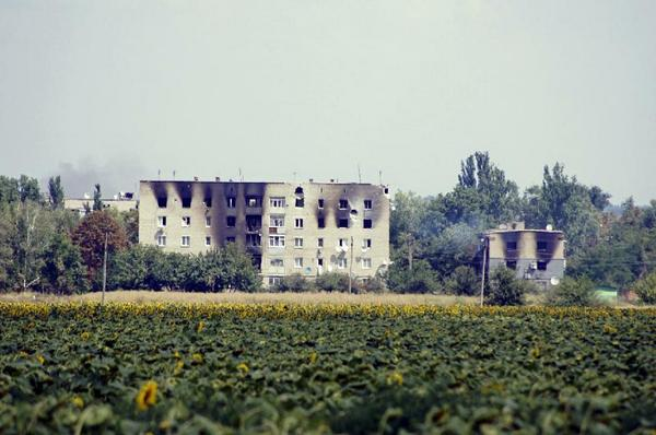 Burnt buildings in the village of Maryinka, a suburb of Donetsk