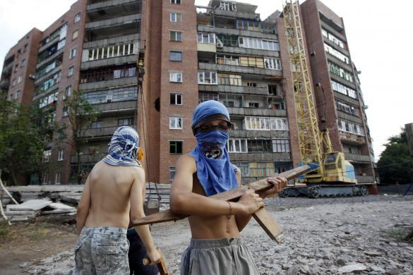 Boys play a game of war between the army and separatists in Ukraine