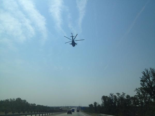 2 Rus military helicopters flew over road of convoy  also passed 4 military vehicles