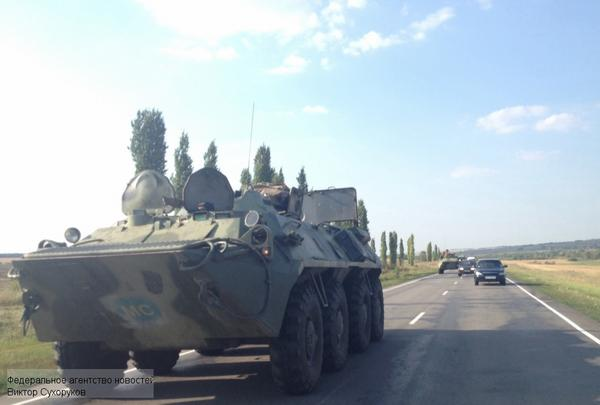 Military vehicles in Rostov region with peacekeeping signs
