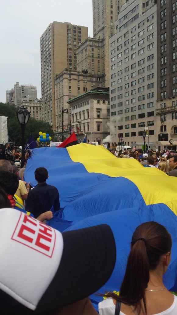 Putin Huilo trucker hats, giant Ukraine flag. NYC is celebrating the freedoms Russians are denied
