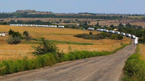 Russian convoy going through fields