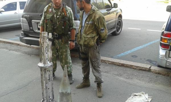 In Donetsk, one fighter says he's from Grozny. Other wearing GRU emblem 'Military Intelligence of Russian Federation'