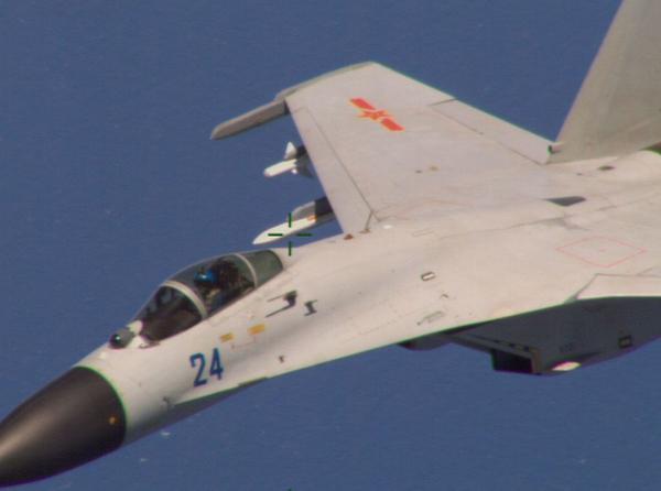 Chinese fighter jet barrel-rolls over U.S. Navy spy plane