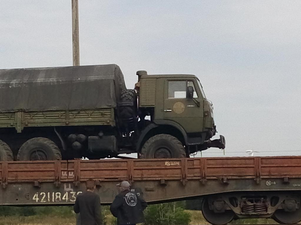RF military 'peacekeeper' equip on a Belorussian train bound for Ukraine