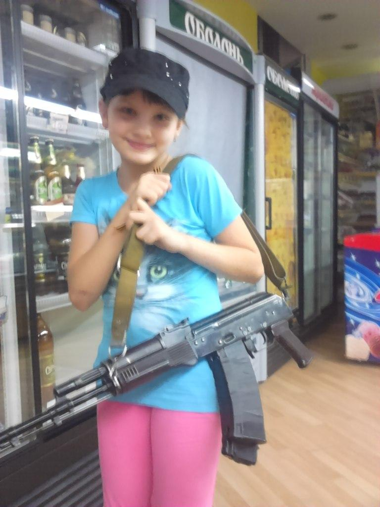 Little girl with AK. DNR