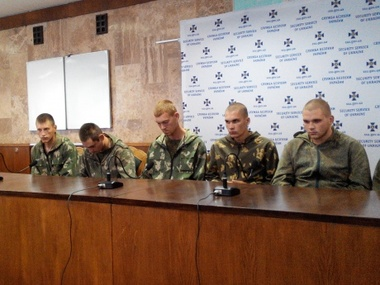 Detained Russian troopers hold a presser in Kyiv