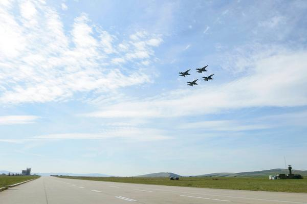 CF-18 Hornets depart CampiaTurzii on their way to NATO Ally Lithuania as part of OpReassurance in Eastern Europe