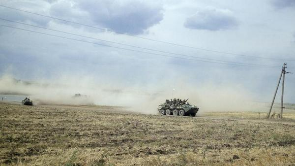 Column of Russian armored vehicles heading to Ukraine - Reuters