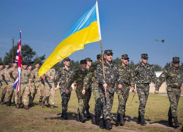 Ukrainian delegation marches during opening ceremonies of Exercise Combined Endeavor 2014 multilateral training