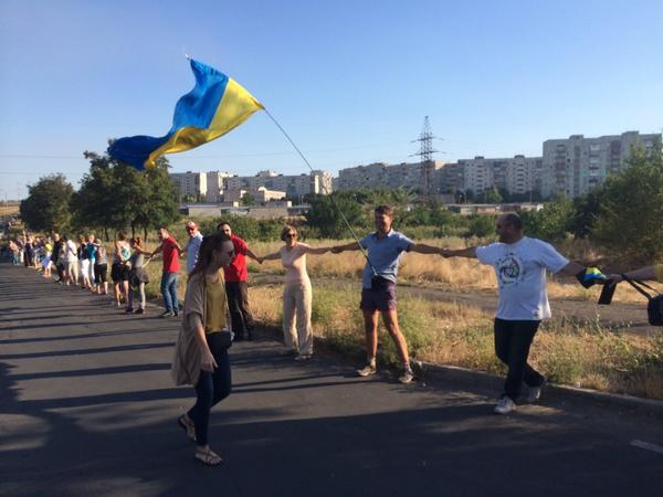 Meanwhile at the outskirts of Mariupol, a big rally. 'Away with Putin, this town is Ukrainian'